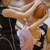 Abbey Nauman stuggles to hold on to the ball during the Eagles pressing defense.