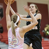 Lyndsey Knowles attempts to block a layup by Ali Berry