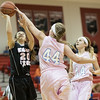 Sarah Southers gets a hand on a shot from Nicole Jefferson