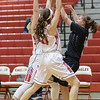 Haley Cave and Nicole Jefferson force a turn over as Lee inbounds the ball