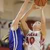 Sage Fox goes for a shot guarded by Madison Smallwood