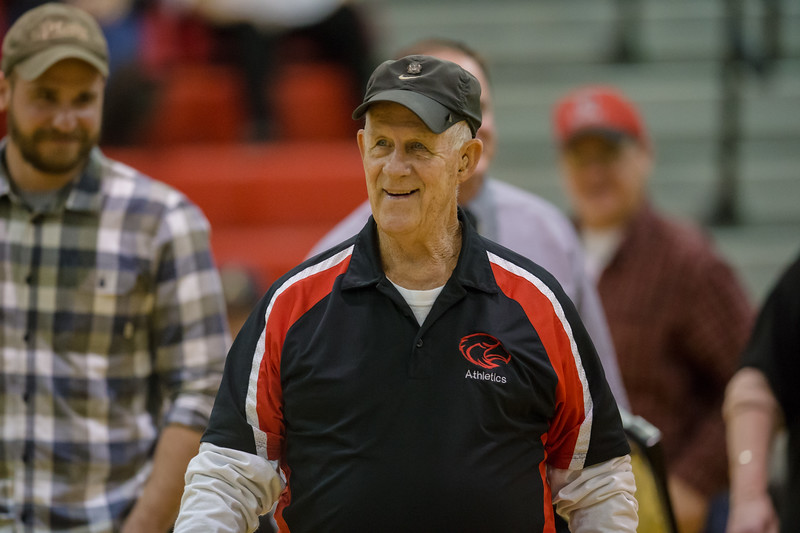 Longtime Girls Baketball Bus Driver Roger Herring is honored during halftime of the boys game.