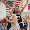 Mary-Ruth Shifflett drives the ball in against Jakaya Brandon