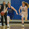 Alexis Bennington-Horton brings the ball back down court by Brianna Allen