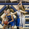 Stephanie Ouderkirk fights to bring in a rebound