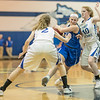 Blair McGloon forces her way in to the lane with pressure from Faith Farley (2) and Brianna Allen (10)