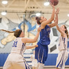 NaKaila Gray goes up a layup aginst Cailin Wright (31) and Faith Farley (2)