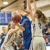 Brooke Vetter tries to get a shot off against Brianna Allen (10) and Faith Farley (2)