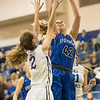 Casey Irvine powers up a shot above Faith Farley