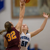 Stephanie Ouderkirk reachs for the jumpball against Brookvilles Hannah Young