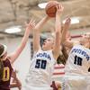 Stephanie Ouderkirk pulls down a rebound