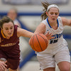 Blair McGloon and Hannah Young both reach for a loose ball