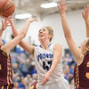 Casey Irvine goes in for a shot guarded by Madisyn Tyree (42) and Hannah Young (32)