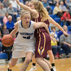 Stephanie Ouderkirk cuts around the corner to get to the basket