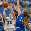 Brooke Vetter powers up to a shot against Brianna Allen