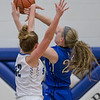 Casey Irvine tries to block a shot