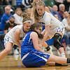 Brooke and Merredith Vetter work to strip the ball from Kaleigh May