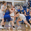 Brooke Vetter and Blair McGloon pressure Brianna Allen as she tries to get the ball down court