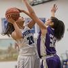 Chloe Brooks takes a jumpshot as Geovanna Salvieti attempts to block