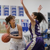 Chloe Brooks looks at a shot being guarded by Geovanna Salvieti