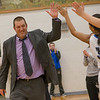 Coach Dodson high fives his team as he walks out to claim District Coach of the Year