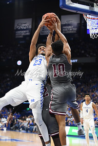 Kentucky's EJ Montgomery and SIU's Aaron Cook battle for a rebound on Friday evening.  MARTY CONLEY/ FOR THE DAILY INDEPENDENT