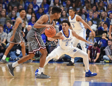 Kentucky's Quade Green defends Southern Illinois' Aaron Cook on Friday evening.  MARTY CONLEY/ FOR THE DAILY INDEPENDENT