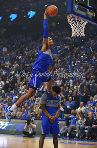 Kentucky's PJ Washington jumps over Quade Green during the dunk contest at Big Blue Madness on Friday evening.  MARTY CONLEY/ FOR THE DAILY INDEPENDENT