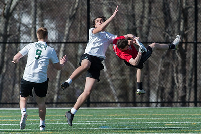 Abington's #1 Mohammed Zaidan (in white) comes up with the defensive play to prevent a Bridgewater-Ryanham goal in early Ultimate Frisbee action in Abington on 4/26/18. Abington would go on to win the game 15-4 [Wicked Local Photo/Bill Marquardt]