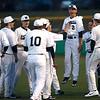 4-20-18<br /> Kokomo vs Western baseball<br /> Western's Reagan Carter celebrates with teammates after striking out Kokomo's last batter and winning the game.<br /> Kelly Lafferty Gerber | Kokomo Tribune