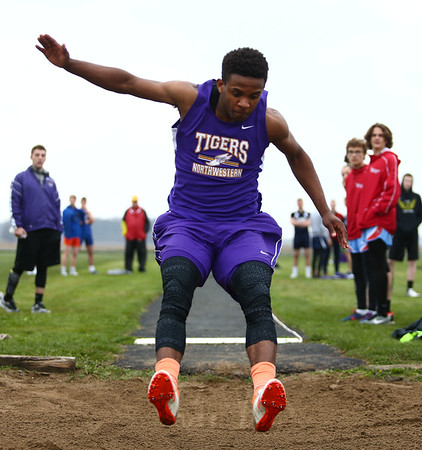 4-24-18<br /> Northwestern Relays<br /> NW's Tayson Parker in the long jump.<br /> Kelly Lafferty Gerber | Kokomo Tribune