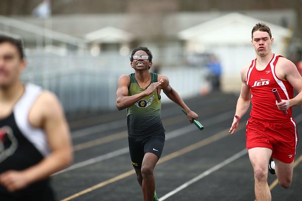 4-21-18<br /> Eastern Relays<br /> Jaeden Hannah, center, in the boys sprint medley relay.<br /> Kelly Lafferty Gerber | Kokomo Tribune
