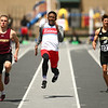 4-28-18<br /> Kokomo Relays<br /> Kokomo's Steven Edwards, center, takes flight in the boys 100 m dash.<br /> Kelly Lafferty Gerber | Kokomo Tribune