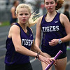 4-24-18<br /> Northwestern Relays<br /> NW's Lauren Longshore takes the baton in the girls distance medley relay.<br /> Kelly Lafferty Gerber | Kokomo Tribune