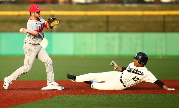 4-20-18<br /> Kokomo vs Western baseball<br /> Kokomo's Noah Hurlock tosses to first in an attempt for a double play after getting Western's Myles Griffith out at second.<br /> Kelly Lafferty Gerber   Kokomo Tribune