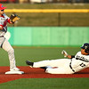 4-20-18<br /> Kokomo vs Western baseball<br /> Kokomo's Noah Hurlock tosses to first in an attempt for a double play after getting Western's Myles Griffith out at second.<br /> Kelly Lafferty Gerber | Kokomo Tribune