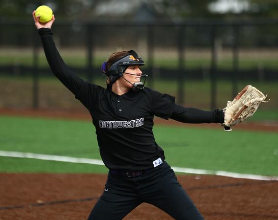 4-17-18<br /> Northwestern vs Western softball<br /> NW's Madison Walker pitches.<br /> Kelly Lafferty Gerber