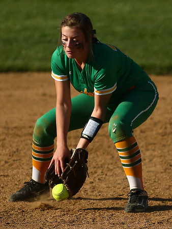 4-26-18<br /> Eastern vs Rossville softball<br /> Brooklynn Smith scoops up the ball.<br /> Kelly Lafferty Gerber   Kokomo Tribune