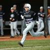 4-18-18<br /> Northwestern vs Western baseball<br /> NW's A.J. Hobson runs home, scoring a run for Northwestern.<br /> Kelly Lafferty Gerber | Kokomo Tribune