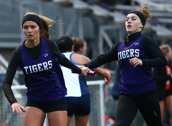 4-24-18<br /> Northwestern Relays<br /> NW's JoHannah Hetzner passes the baton off to Hope Braun in the girls 4x400 relay.<br /> Kelly Lafferty Gerber   Kokomo Tribune