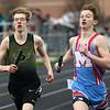 4-24-18<br /> Northwestern Relays<br /> Eastern's Evan Monize, left, in the boys sprint medley relay.<br /> Kelly Lafferty Gerber | Kokomo Tribune