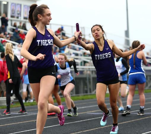 4-24-18<br /> Northwestern Relays<br /> NW's Sasha Jocius passes the baton off to Lauryn Fackler in the girls distance medley relay.<br /> Kelly Lafferty Gerber | Kokomo Tribune