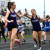4-24-18<br /> Northwestern Relays<br /> NW's Sasha Jocius passes the baton off to Lauryn Fackler in the girls distance medley relay.<br /> Kelly Lafferty Gerber | Kokomo Tribune