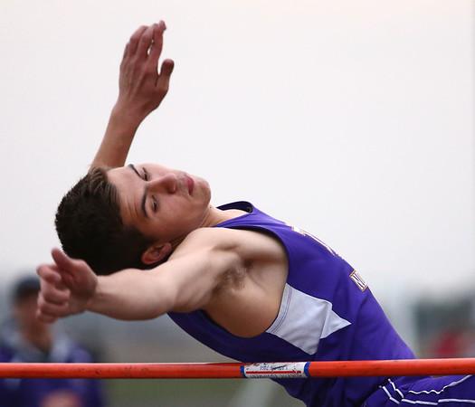 4-24-18<br /> Northwestern Relays<br /> NW's Gus Bourff in the high jump.<br /> Kelly Lafferty Gerber   Kokomo Tribune