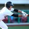 4-20-18<br /> Kokomo vs Western baseball<br /> Western's Reagan Carter bunts.<br /> Kelly Lafferty Gerber | Kokomo Tribune