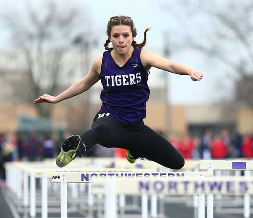 4-24-18<br /> Northwestern Relays<br /> NW's Madison Prifogle in the shuttle hurdle relay.<br /> Kelly Lafferty Gerber | Kokomo Tribune