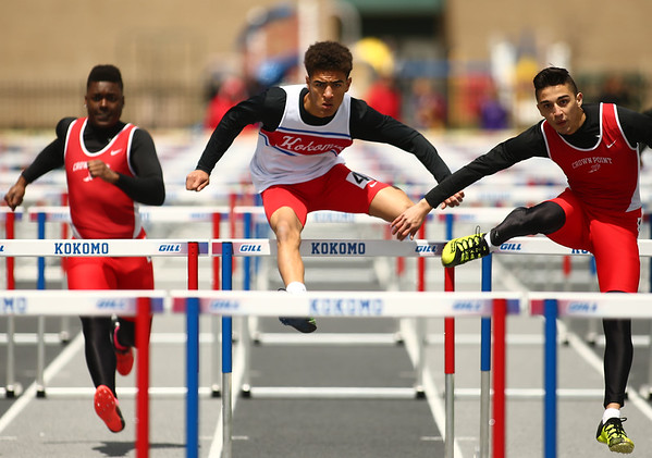 4-28-18<br /> Kokomo Relays<br /> Kokomo's Quincy Armstrong (center) in the 110 m hurdles.<br /> Kelly Lafferty Gerber | Kokomo Tribune