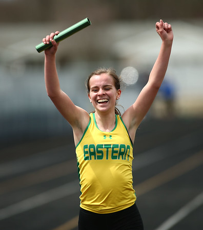 4-21-18<br /> Eastern Relays<br /> Victoria Leeder celebrates after she finishes the final leg of the girls distance medley relay in first place.<br /> Kelly Lafferty Gerber | Kokomo Tribune