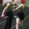4-21-18<br /> Eastern Relays<br /> Caleb Vogl hands the baton off to Joshua Reprogle in the boys distance medley relay.<br /> Kelly Lafferty Gerber | Kokomo Tribune