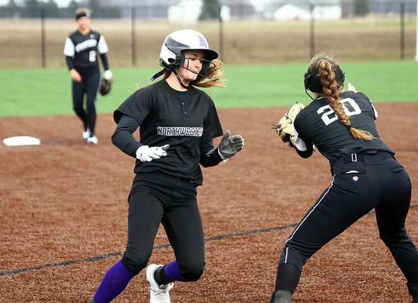4-17-18<br /> Northwestern vs Western softball<br /> NW's Kendal Roze manuevers to third safely.<br /> Kelly Lafferty Gerber